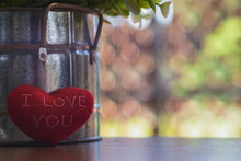 """Red Hearts """"I LLove You""""on Wooden Table With Beautiful Blurred Background"""