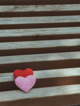 Red And Pink Hearts On Wooden Chair With Beautiful Blurred Background