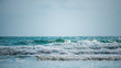 canvas print picture - Selective focus the ocean and water splash, Bright water with sun reflection at the sea