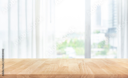 Obraz Empty of wood table top on blur of white curtain with window view background - fototapety do salonu