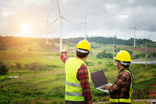 Two Engineering Work With Together At The Windmill Farm