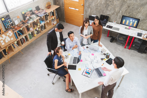 Fototapety, obrazy: Group of Asian business people and creative designer meeting in office, top view