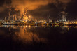 night view of a petrochemical plant on the banks of the Seine River
