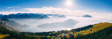 Panoramic Drone View Over Snow Covered Mountains During Autumn, Aerial View Over Swiss Alps With Lake In Fog Covered, Rigi Switzerland