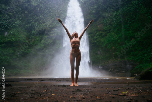 Fototapety, obrazy: Beautiful girl having fun at the waterfalls in Bali. Concept about wanderlust traveling and wilderness culture