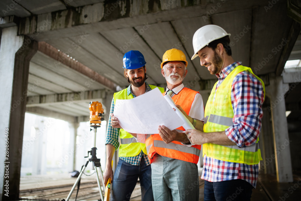 Fototapety, obrazy: Engineer, foreman and worker discussing in building construction site