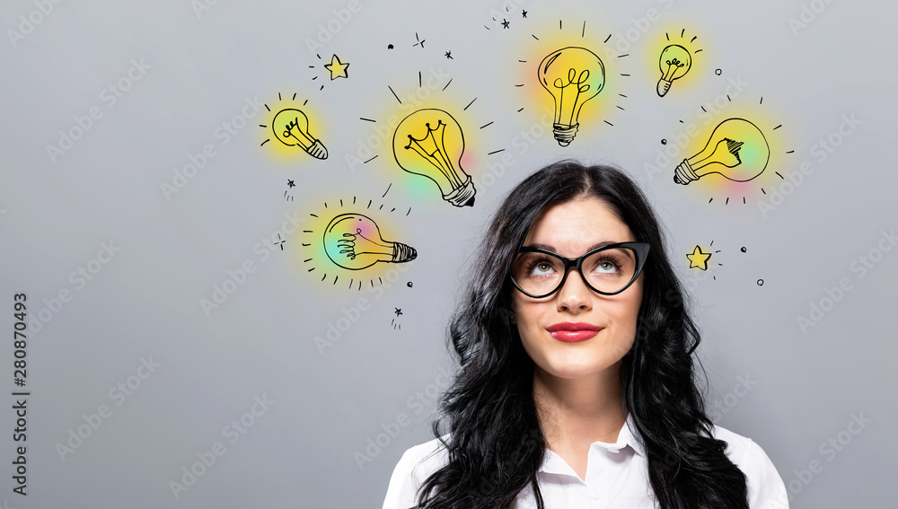 Fototapety, obrazy: Idea light bulbs with young businesswoman in a thoughtful face