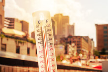 Thermometer In Front Of An Urb...