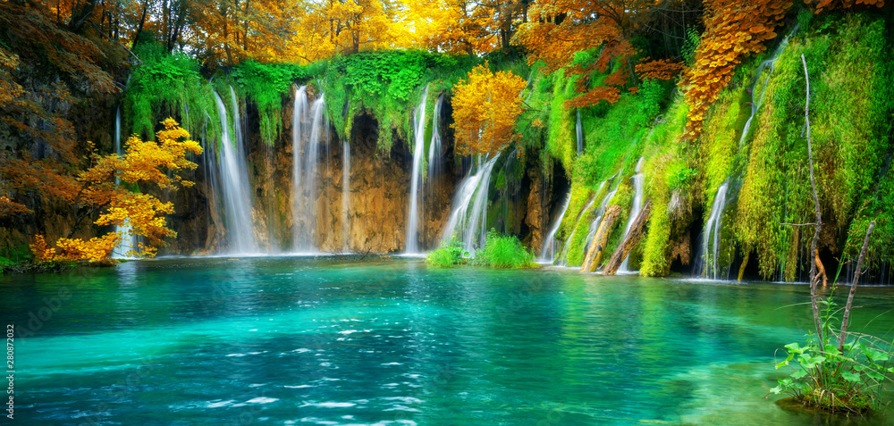 Fototapeta Exotic waterfall and lake landscape of Plitvice Lakes National Park, UNESCO natural world heritage and famous travel destination of Croatia. The lakes are located in central Croatia (Croatia proper).