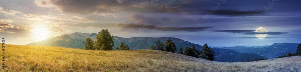 Fototapeta beautiful panoramic landscape in august. row of beech trees on the meadow in weathered grass. mountain range in the distance with sun and moon on the sky. day and night time change concept