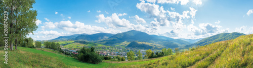 Montage in der Fensternische Blau beautiful rural area of carpathian mountains. trees and agricultural fields on hills. panoramic landscape in dappled light. forest on the distant ridge. sunny weather with clouds on the afternoon sky