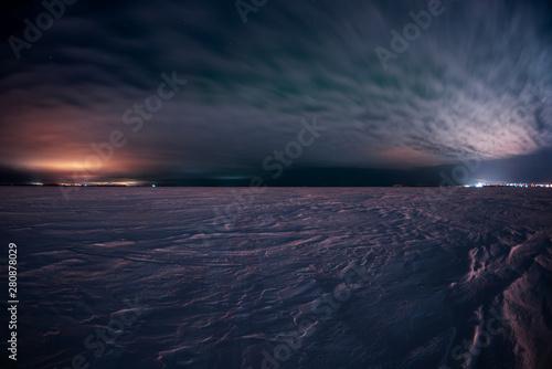 Fototapeta  Snowy field at night