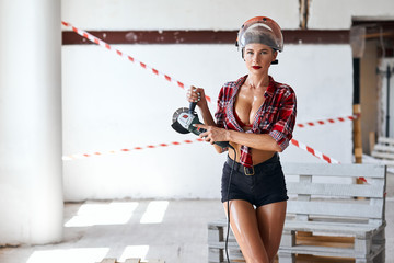 first helper for builders. sexy girl going to polish the surface . close up photo. copy space