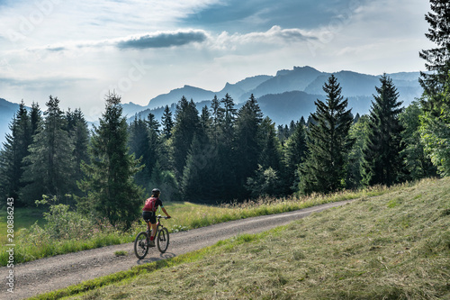 Fototapeta  nice, active senior woman underway with her electric mountain bike in the Bregen