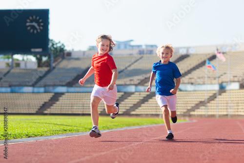 plakat Child running in stadium. Kids run. Healthy sport.