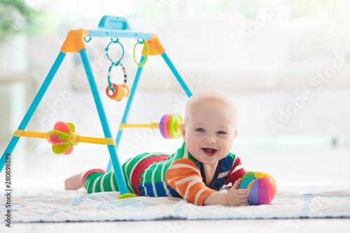 Obraz Baby boy with toys and ball - fototapety do salonu