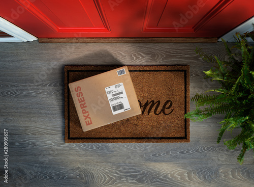 Obraz Expedited delivery box outside front door. Overhead view - fototapety do salonu