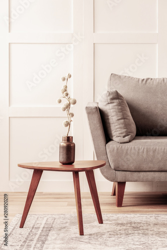 Awe Inspiring Cotton Flower In Vase On Wooden Coffee Table Next To Grey Uwap Interior Chair Design Uwaporg