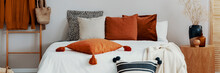 Decorative Pillows On A Bed In...