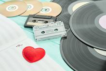 Outdated Musical Objects Close Up. Vinyl Records, Audio Cassettes, Compact Discs, Musical Notes. Love Music Concept.