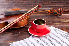 Violin And Coffee Cup On Music...