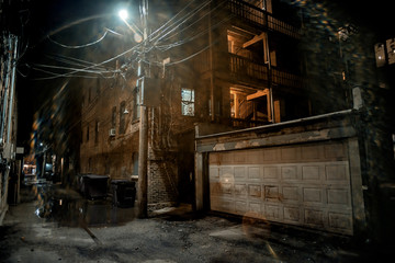 Fototapeta na wymiar Dark and scary vintage city alley at night in Chicago