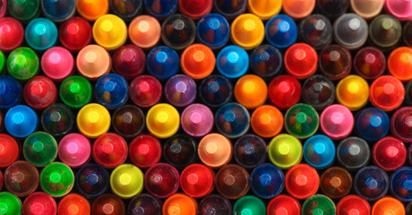 Collection of colorful crayons mixed together