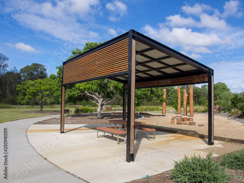 Modern pergola and sitting area with play ground behind in Public Park Fototapeta