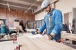 Successful handsome businessman with stylish cap work in carpentry