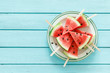 canvas print picture - Watermelon slice popsicles, blank food background with space for a text, top view