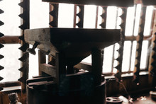 Old Mill For Grain, Against The Background Of The Window. Agricultural Production