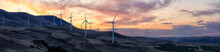 Beautiful Panoramic Landscape View Of Wind Turbines On A Windy Hill During A Colorful Sunrise. Taken In Washington State, United States Of America.