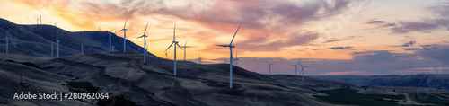 Beautiful Panoramic Landscape View of Wind Turbines on a Windy Hill during a colorful sunrise Obraz na płótnie