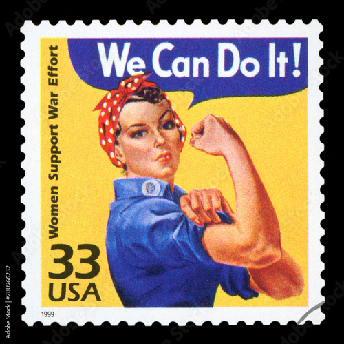 Cuadros en Lienzo UNITED STATES - CIRCA 1999 : Canceled US Postage stamp showing an image of Rosie The Riveter commemorating the American woman who worked in factories during the World War II, circa 1999