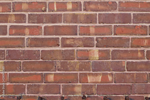 Valokuva  Rough textured and weathered antique brick wall background with brown striations