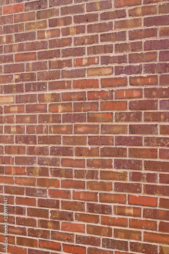 Valokuvatapetti Rough textured and weathered antique brick wall background with brown striations