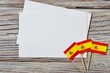 October 12. Independence day Spain, the concept of independence , patriotism and freedom. Mini paper flags with white postcards on wooden background