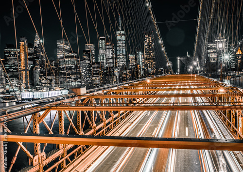direct on view of long exposure traffic on the Brooklyn Bridge with lower Manhattan
