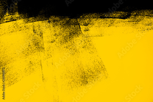 Fototapeta yellow and black paint  background texture with brush strokes obraz