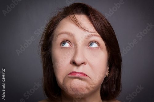 Valokuva  Woman grimaces in front of camera