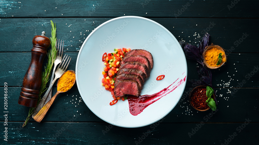 Fototapety, obrazy: Veal baked with vegetables. In the plate. Top view. Free space for your text.