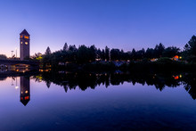 Panorama Of Clock Tower At Twilight Along A River