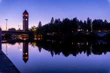 Clock Tower Reflections On River At Twilight