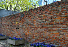 Remaining Fragment Of The Jewish Ghetto Wall In Warsaw, Poland