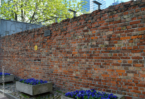 Photo Remaining fragment of the Jewish ghetto wall in Warsaw, Poland