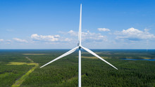 Wind Turbine In Summer Forest, Close Up. Colorful Aerial Landscape. Alternative Energy Concept.