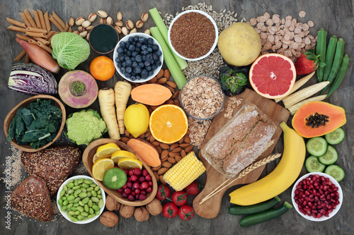 Aluminium Prints High fibre super food with whole grain bread loaf and rolls, fruit, vegetables, whole wheat pasta, cereals, seeds and nuts. Foods omega 3, anthocyanins, antioxidants and vitamins. Top view.