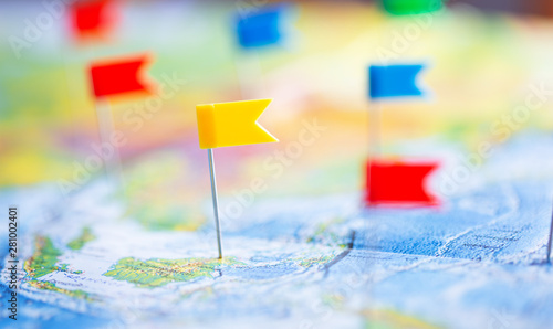 Fotografía  Travel concept with colored flag pushpins and world map, close up