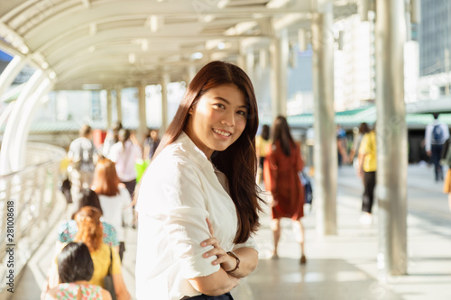 Foto op Plexiglas Bakkerij Portrait of young beautiful Asian businesswoman cross her arm.
