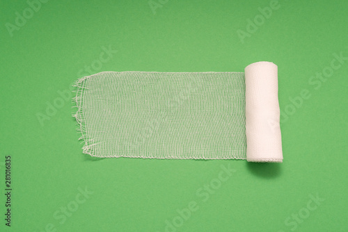 Valokuva medical bandage isolated on green background